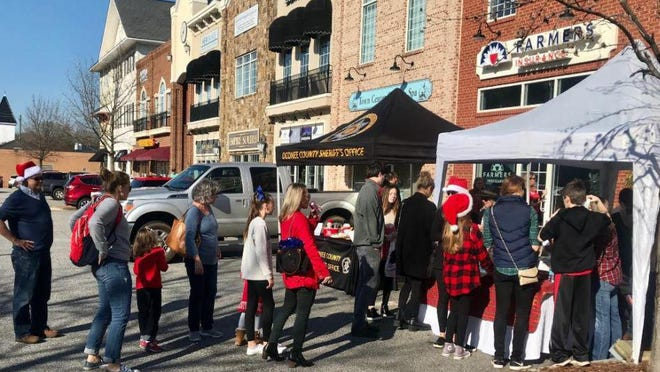 Last year, the first Very Merry Cookie Crawl took place in conjunction with the Christmas parade in Watkinsville. The event returns Sunday.