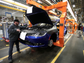 A worker assembles a 2015 Chrysler 200 at the Sterling