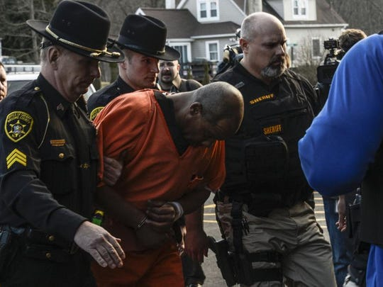 Aaron Powell walks into Binghamton Town Court on March 26, 2013, where he was charged with felony counts of murder.
