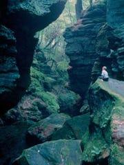 Visitors enjoy the cool shade among the canyon walls