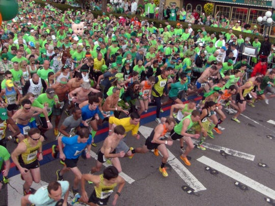 Thousands of runners take off from the starting line