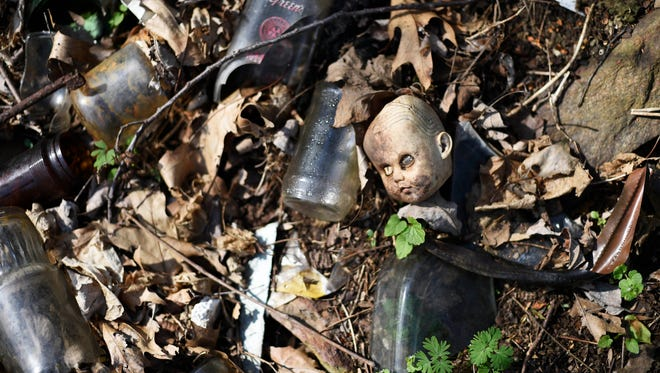 Old toys, bottles, shoes, tires and rusted appliances are litter the hillside surrounding a section of the Mason-Dixon Trail in Chanceford Township.