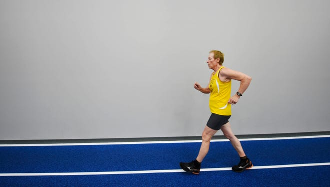 Lana Kane race walks around the track at Spooky Nook Sports.