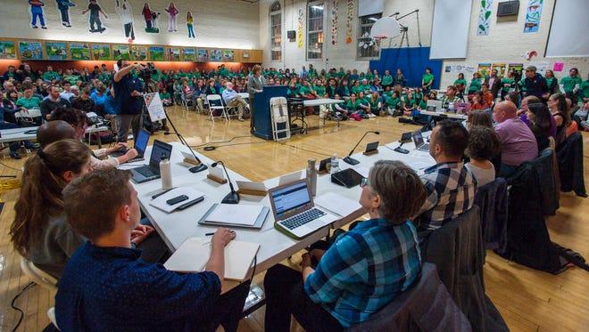 Fran Brock, president of the Burlington Education Association, center, speaks during the public comment portion of a meeting of the Burlington School Board in Burlington on Thursday, October 13, 2016.