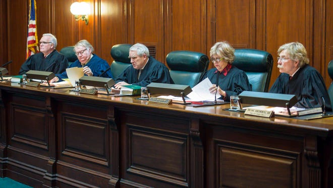 The Vermont Supreme Court in Montpelier considers on Tuesday, January 3, 2017, an effort by House Republican leader Rep. Don Turner, R-Milton, to prevent outgoing Gov. Peter Shumlin from appointing a successor to outgoing Supreme Court Justice John Dooley.  Dooley's term ends after Shumlin leaves office. From left to right are Associate Justice Harold Eaton Jr., Associate Justice John Dooley, Chief Justice Paul Reiber, Associate Justice Marilyn Skoglund and Acting Justice Walter Morris, Jr.
