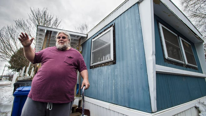 Todd Alexander of Milton, seen on Tuesday, March 28, 2017, has been on the waiting list to have his home weatherized for three years.  In the interim he has been taking on some projects himself.  For instance he has replaced the windows and doors on his home that was built in 1980.