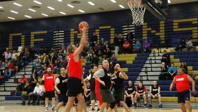 Legislators, including state Sen. Bill Soules, D-Las Cruces, with the ball in his hands, take to the court Wednesday, March 1, to raise funds for the UNM Cancer Center.