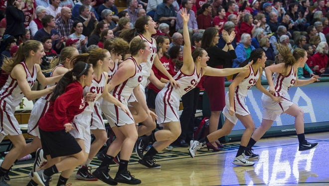 CVU players celebrate their victory over BFA in the Division I high school girls basketball state championship in Burlington on Tuesday.