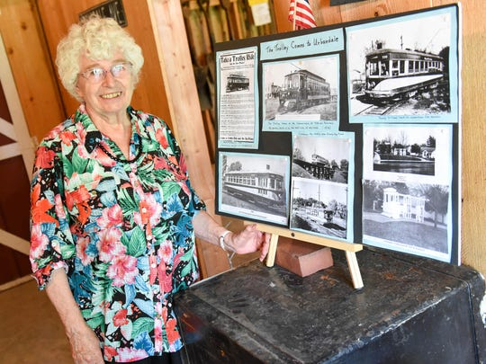 Urbandale Historical Society board member Virginia Gee stands with a display she put together for the 2015 Urbandale Historical Society ice cream social at the Olmsted-Urban House in Urbandale.