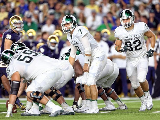 Sep 17, 2016; South Bend, IN, USA; Michigan State Spartans quarterback Tyler O'Connor (7) looks over as tight end Josiah Price (82) motions across the formation against the Notre Dame Fighting Irish during the second half a game at Notre Dame Stadium.
