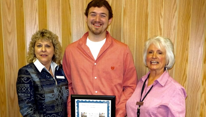 Ozark Earth Science Gem, Mineral & Fossil Club awarded student Clifford Curtis II a $250 Science Scholarship to Arkansas State University Mountain Home. Curtis is a graduate of Flippin High School. His parents are Jack & Michelle Curtis of Flippin. Shown are, from left, Catherine Doyle, club president, Curtis and Sandra Chandler, Arkansas State Geologist.