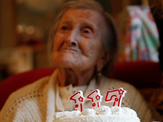 Emma Morano is pictured behind a cake with candles