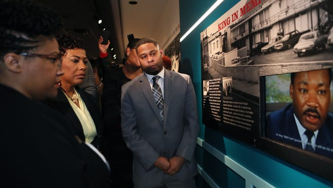 """April 2, 2018 - (Left to right) Dr. Noelle Trent, director of interpretation, collections and education, Rev. Dr. Bernice King, daughter of civil rights icons Dr. Martin Luther King, Jr. and Coretta Scott King, and Ryan Jones, museum educator and lead tour guide, watch a video clip of Dr. King in Memphis during a tour of the new exhibit, """"MLK50: A Legacy Remembered,"""" at the National Civil Rights Museum on Monday."""