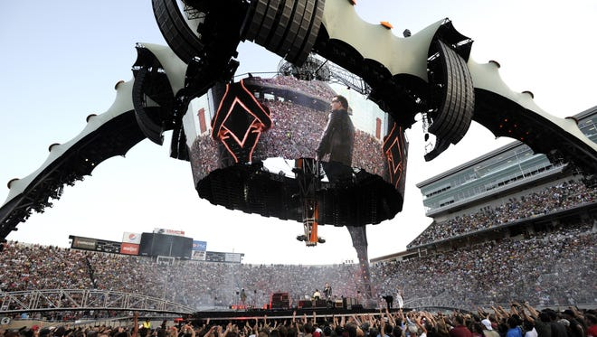 """U2's stage setup at its June 2011 concert inside MSU's Spartan Stadium was nicknamed """"The Claw."""" It was a 165-foot structure with four pronged feet and a cylinder-shaped video screen."""