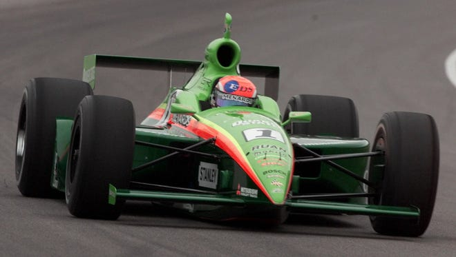 Race driver Greg Ray of Dallas speeds through the first turn at the Indianapolis Motor Speedway during the practice session on the opening day of qualifications for the 84th running of the Indy 500 Saturday May 20 2000.  Ray qualified with an average speed of 223.471.