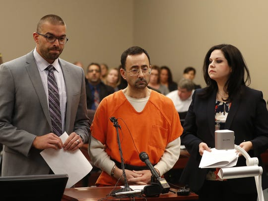 Larry Nassar, 54, appears in court for a plea hearing