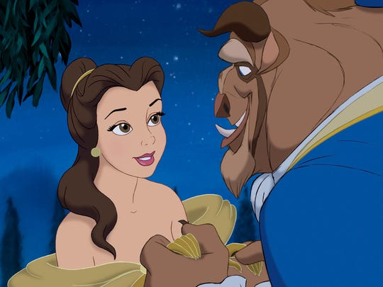 Belle (voiced by Paige O'Hara) and the Beast (Robby