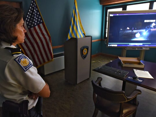 "In this file photo, Salisbury Police Chief Barbara Duncan watches a video about a Salisbury Police officer that discharged his weapon during a ""man with a gun call"" at Woodcock Park at Pennsylvania Avenue and Riverside Road."