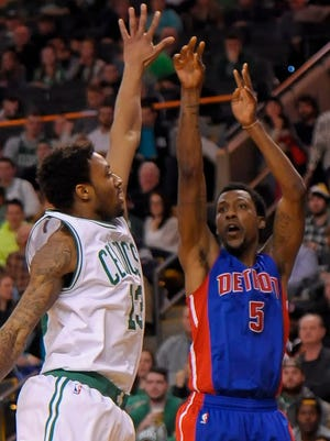 Detroit Pistons guard Kentavious Caldwell-Pope (5) shoots over Boston Celtics guard James Young (Rochester) during the second half at TD Garden.
