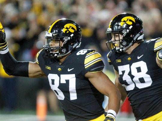 IOWA CITY, IOWA- SEPTEMBER 22:  Tight ends Noah Fant #87  and T.J. Hockenson #38 of the Iowa Hawkeyes celebrate a touchdown during the first half against the Wisconsin Badgers on September 22, 2018 at Kinnick Stadium, in Iowa City, Iowa.  (Photo by Matthew Holst/Getty Images)
