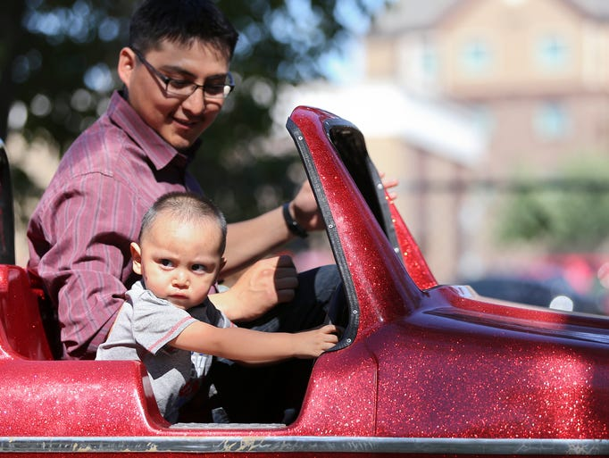 Jacob Freeman, 1, has a little road rage during his trip on one of the rides with his dad, Jake Freeman on Saturday.