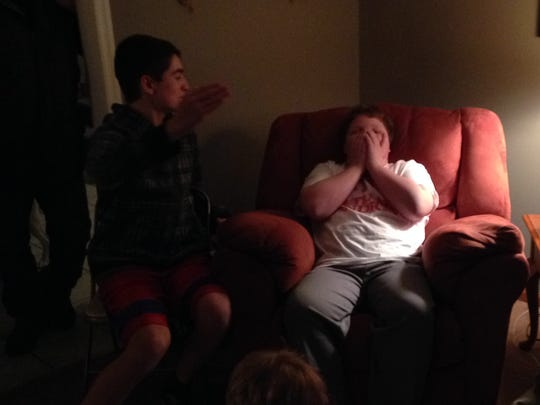 Andrew Zappley (right), 12, waits for the results of