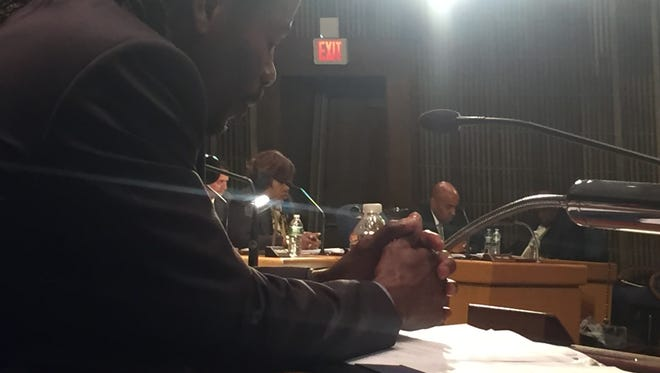 Wilmington Councilman Nnamdi Chukwuocha participates on Jan. 19 in silent reflection, a new practice in place of the prayer during City Council meetings.
