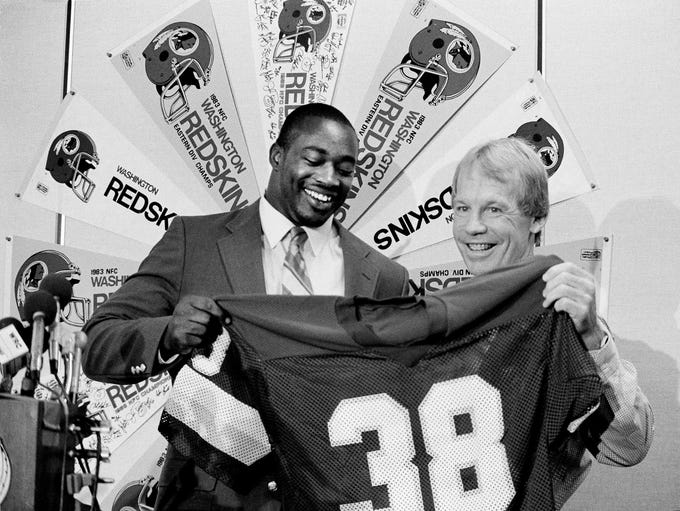 Bobby Beathard, right, general manager of the Washington