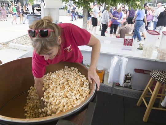 Jan Frumes of A-Maize'n Kettle Corn tosses caramel