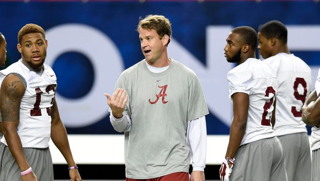 Kiffin works with quarterbacks and receivers during practice at the Georgia Dome before the SEC championship game.