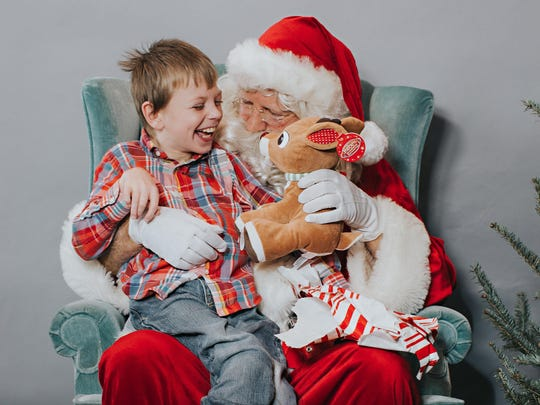 Camden Bailey, a Hang Tough Hero who is diagnosed with Cerebral Palsy, enjoys a sweet moment with Santa Claus during Hang Tough Foundation's Santa Day event.
