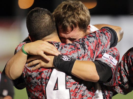 "UL's Jace Conrad (19) and Blake Trahan (4) show their emotions after UL's 10-4 loss to Ole Miss in the third game of the 2014 NCAA Division I Super Regional baseball tournament Monday, June 9, 2014, at M.L. ""Tigue"" Moore Field in Lafayette, La."