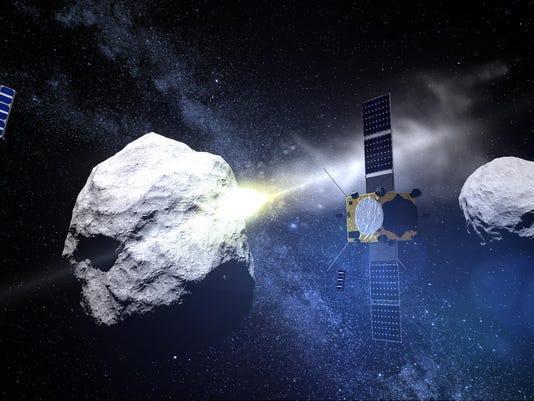 FILES-SPACE-EUROPE-USA-SCIENCES-SATELLITE-AIM-DART