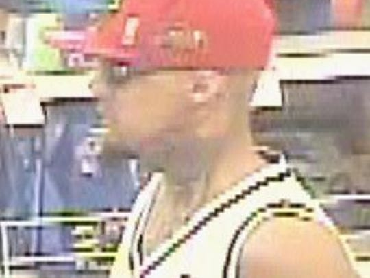Security camera image of the suspect in the April 25 robbery of a Kmart pharmacy at 6375 Montana Avenue.