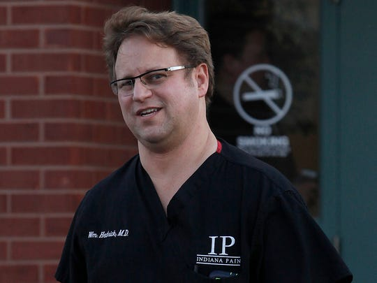 Dr. William Hedrick walks out of his pain clinic at
