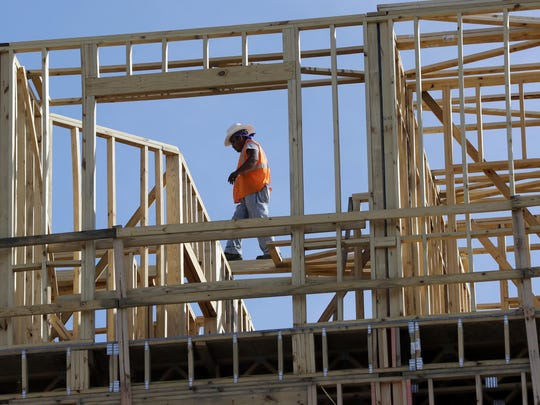 In this Oct. 6, 2017, file photo, workers build an apartment and retail complex in Nashville, Tenn. U.S. economic growth in the first quarter was revised down to a lackluster 2 percent, a sharp deceleration and the poorest showing in a year. But economists expect a significant rebound in the current quarter, forecasting a sizzling growth rate of 4 percent or more.