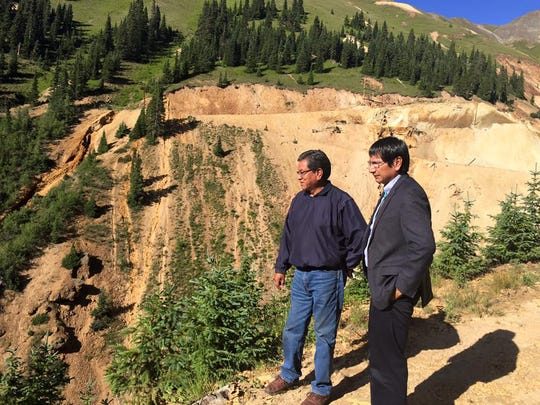 From left, Navajo Nation President Russell Begaye and Vice President Jonathan Nez look on Aug. 9 at the toxic waste water spill into the Animas River from the Gold King Mine north of Silverton, Colo.
