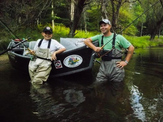 Mike and Bryan Hermann participate in the Flyin' Heroes program for veterans.