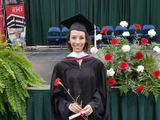Emily Recchia poses after earning her master's degree from Indiana University-Purdue University Indianapolis in May 2016.