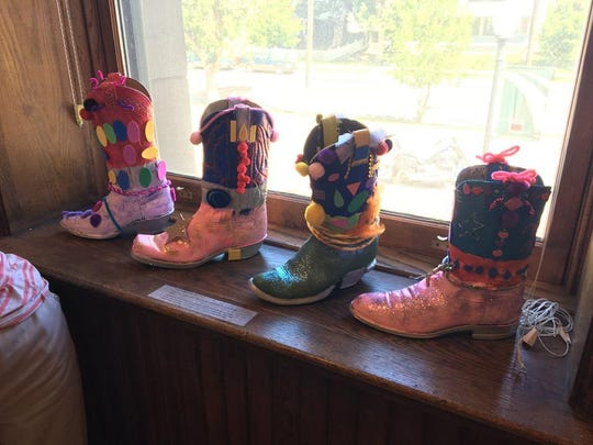 In addition to individual painting, sculpture, pottery and mixed media instruction, students also get the opportunity to create collaborative projects like these decked-out cowboy boots.