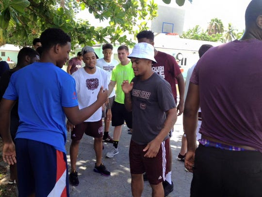 Missouri State senior Dequon Miller greets some of the residents of the Ranfurly Children's Home during the team's trip to the Bahamas last week.