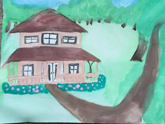 "Meghan Laughman painted this picture of a house she's seen in her dreams later determined to be ""grandma's house."""