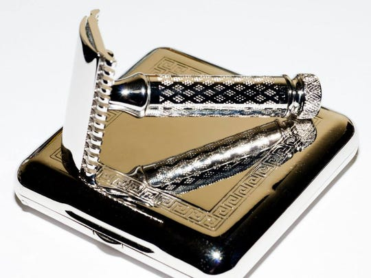 A vintage safety razor and case restored with platinum plating.
