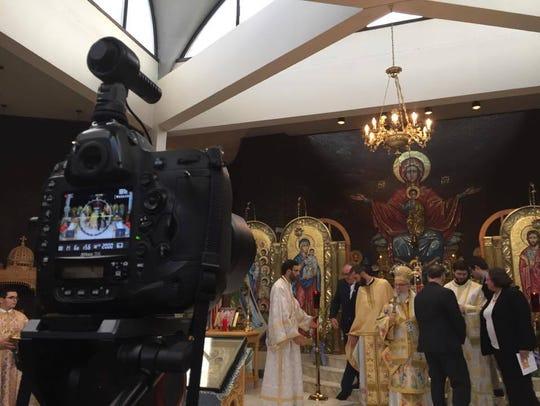 Archbishop Demetrios and church staff prepare to pose