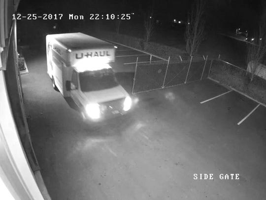 Surveillance footage shows a U-haul truck driving into the Tugwell Roofing Co. parking lot less than a minute after two men apparently cut the lock to burglarize the business.