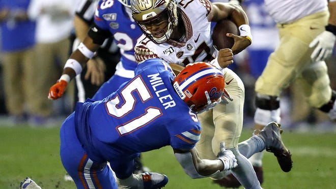 Florida linebacker Ventrell Miller (51) stops Florida State quarterback Jordan Travis during last year's game at Ben Hill Griffin Stadium. Big things are expected from Miller this season.