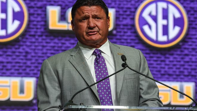 LSU Tigers head coach Ed Orgeron talks to the media during SEC football media day at the College Football Hall of Fame. Mandatory Credit: Dale Zanine-USA TODAY Sports