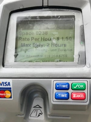 """The city of Asheville is replacing its old parking meters with new """"smart meters"""" that accept credit cards and coins, and have display screens."""