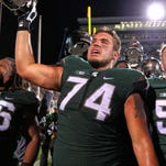 Offensive tackle Jack Conklin celebrates the win over the Oregon Ducks after a game at Spartan Stadium. MSU won 31-28.