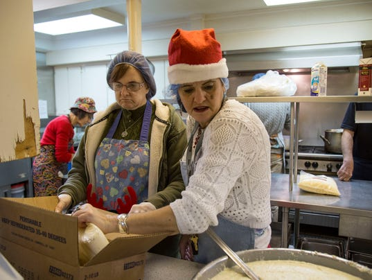 Volunteers pitch in to make christmas meal at loaves fishes for Loaves and fishes volunteer
